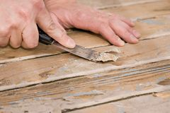 Scraping paint on a deck royalty free stock images