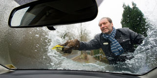 Scraping windscreen Stock Photo