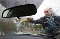 Scraping windscreen Royalty Free Stock Photos