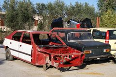 Scrapped cars at a wrecking yard. Vehicle recycling Royalty Free Stock Images