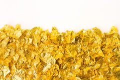Scraps of gold foil Royalty Free Stock Image