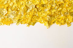 Scraps of gold foil Stock Photography