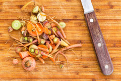 Scraps leftover from cutting carrots beside knife Stock Images