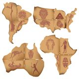 Scraps of old paper in the form of South America, Africa, Austra Royalty Free Stock Images