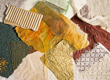 Scraps of painted paper and fabric Royalty Free Stock Image