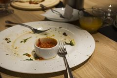 Scraps on the table. Empty plate with leftover food. In the restaurant Royalty Free Stock Images