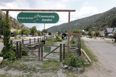 Scraps-to-Soil Community Garden. Idaho Springs, CO, USA - June 24, 2016: Beautiful Community Garden, Scraps-to-Soil and entry signs at 2225 Miner Street. Scraps stock photography