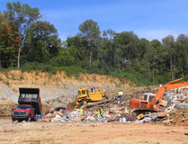 Scrapyard. With the rubbish and excavators and special cars for the  rubbish transportation Royalty Free Stock Image