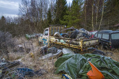 Scrapyard for cars (fully loaded truck). The pictures are shot in january 2013 and shows different car wreck on a scrapyard for cars somewhere in sweden royalty free illustration