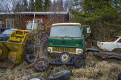 Scrapyard for cars (green truck). The pictures are shot in january 2013 and shows different car wreck on a scrapyard for cars somewhere in sweden vector illustration