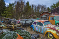 Scrapyard for cars (volkswagen). The pictures are shot in january 2013 and shows different car wreck on a scrapyard for cars somewhere in sweden stock illustration