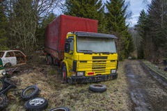 Scrapyard for cars (yellow truck). The pictures are shot in january 2013 and shows different car wreck on a scrapyard for cars somewhere in sweden stock illustration