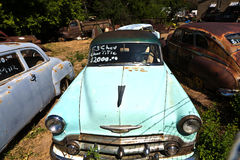 Scrapyard with vintage cars Stock Photos