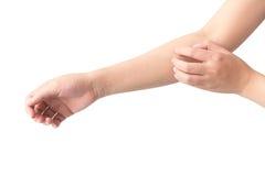 Scratch della mano della donna sul fondo bianco per sano Fotografia Stock