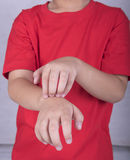 Scratch the itch. Children scratch the itch with hand. Concept photo with Healthcare And Medicine Stock Image