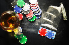 Scratch photo concept addiction cocaine alcohol glass drug. Concept of addiction and alcoholism things on the table and a glass powder Royalty Free Stock Image