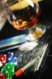 Scratch photo concept addiction cocaine alcohol glass drug. Concept of addiction and alcoholism things on the table and a glass powder Royalty Free Stock Photo