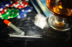 Scratch photo concept addiction cocaine alcohol glass drug. Social problem of drug addiction table with the track of a strange powder and twisted bill stock photos