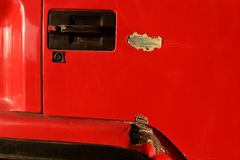 Scratch on surface red door of truck. Detail scratch on surface red door of truck Stock Image