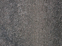 Scratched asphalt. Marks of braking on asphalt caused by car tires meant for snow and ice Royalty Free Stock Photo