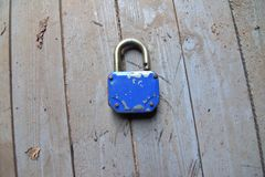 Scratched and blue padlock royalty free stock photo