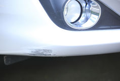 Scratched car front bumper Stock Photos