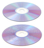 Scratched and clean CD or DVD. A set of two CDs or DVDs of which one is heavily scratched and the oter is clean Stock Photography