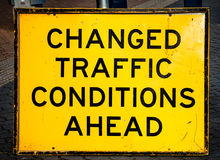 Scratched and Damaged Street Sign Warning CHANGED TRAFFIC CONDIT Royalty Free Stock Photos