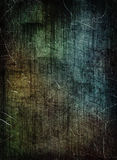 Scratched dark grunge texture as abstract background. Royalty Free Stock Images