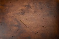 Scratched dark wood texture as background. Texture with cracks and stain.  stock images