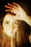 Scratched dirty effect on photo girl face behind dirty glass Stock Photography