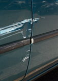 Scratched door paint on a car Royalty Free Stock Images