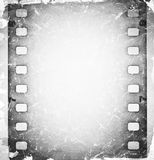 Scratched film strip background. Grunge scratched film strip background Royalty Free Stock Photos