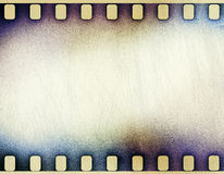 Scratched film strip background. Grunge scratched film strip background Royalty Free Stock Photography