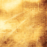 Scratched gold metal background Stock Images