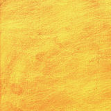 Scratched gold metal texture, yellow shiny background Stock Images