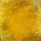 Scratched grungy yellow background Stock Images