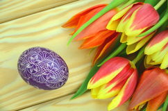 Scratched handmade Easter egg and tulips Royalty Free Stock Images