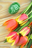 Scratched handmade Easter eggs and tulips Stock Photo