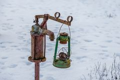Scratched headlamp. Headlamp hanged in the middle of the field in winter stock image