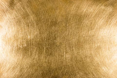 Scratched industrial brass metal plate textured background patte Royalty Free Stock Photos