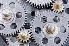 Scratched industrial metal gear cogwheels closeup Stock Photos