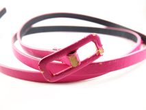 Scratched leather, pink old belt, accessory for woman Royalty Free Stock Photography