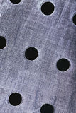 Scratched metal background with holes.  Stock Photography