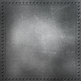 Scratched metal background with rivets Stock Image