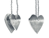 Scratched metal heart pendants Royalty Free Stock Photos