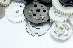 Scratched metal industrial background with plastic gears. indust Stock Photo