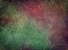 Scratched multicolored texture as abstract background. Royalty Free Stock Images
