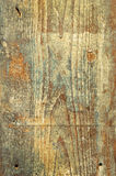 Scratched old wooden board as the background Royalty Free Stock Photo