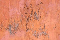 Scratched orange metal surface Stock Photos